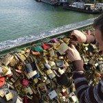 Tourist, Ian installing his and Josie's padlock on Pont des Arts