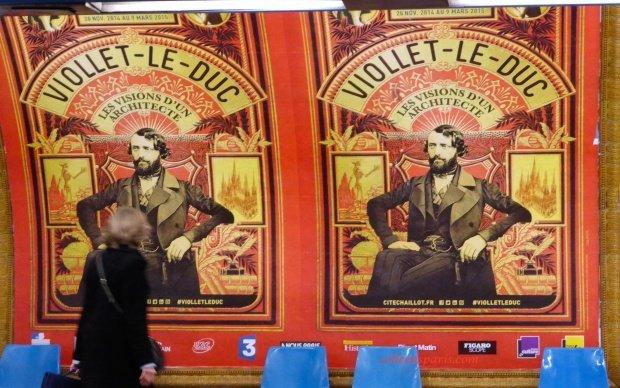 Lady walking in front of the poster for Viollet le Duc exhibit at Cité de l'Architecture et du Patrimoine