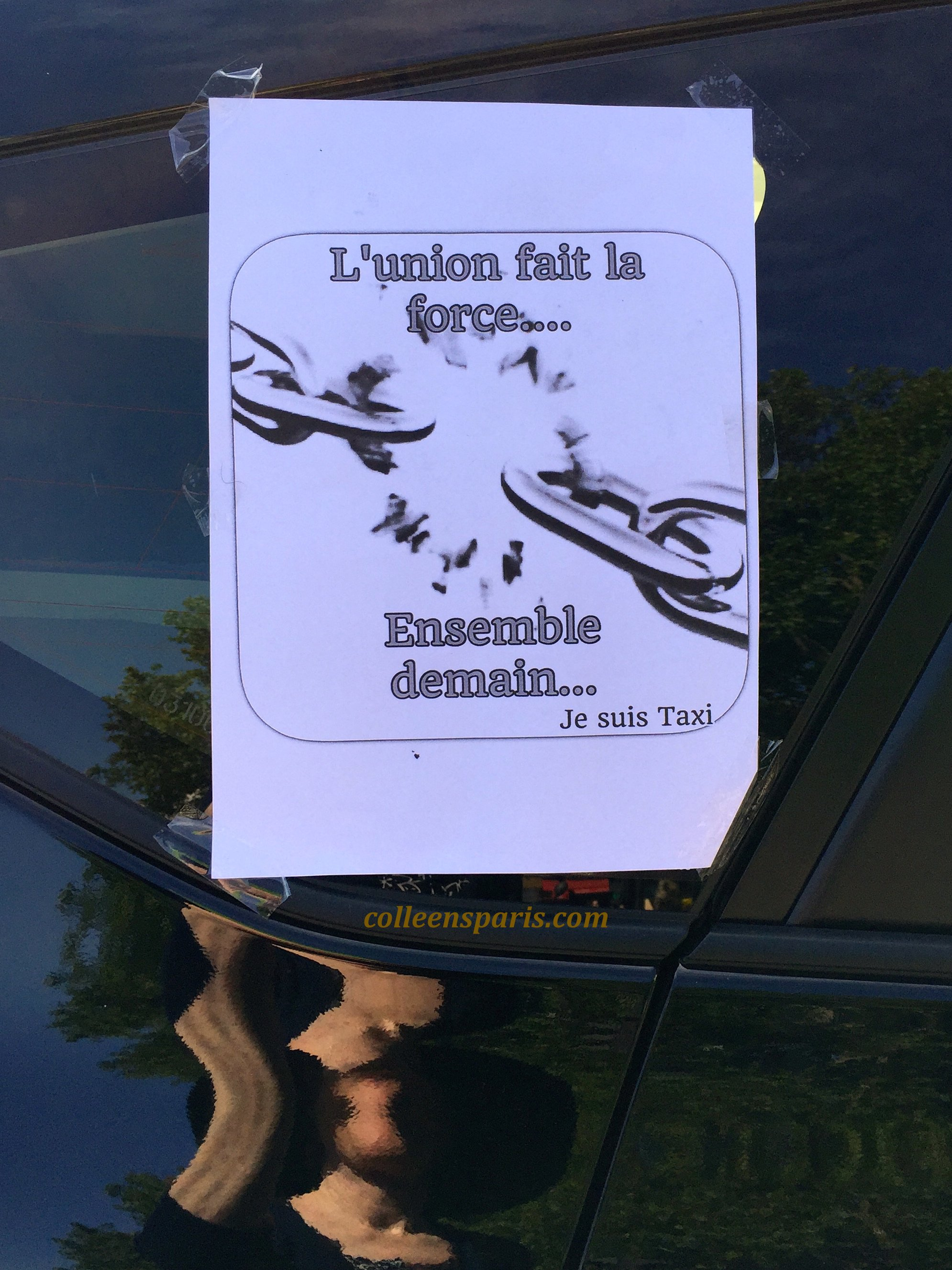 "Taxi Strike at the Bastille and taxis had this sign taped on to their windows ""L'union fait la forcee..ensemble demain"" (""United we are strong....Together tomorrow"" Je suis Taxi"