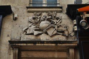 Franc-Maconnerie symbols on facade above doorway at 51 rue Montorgueil