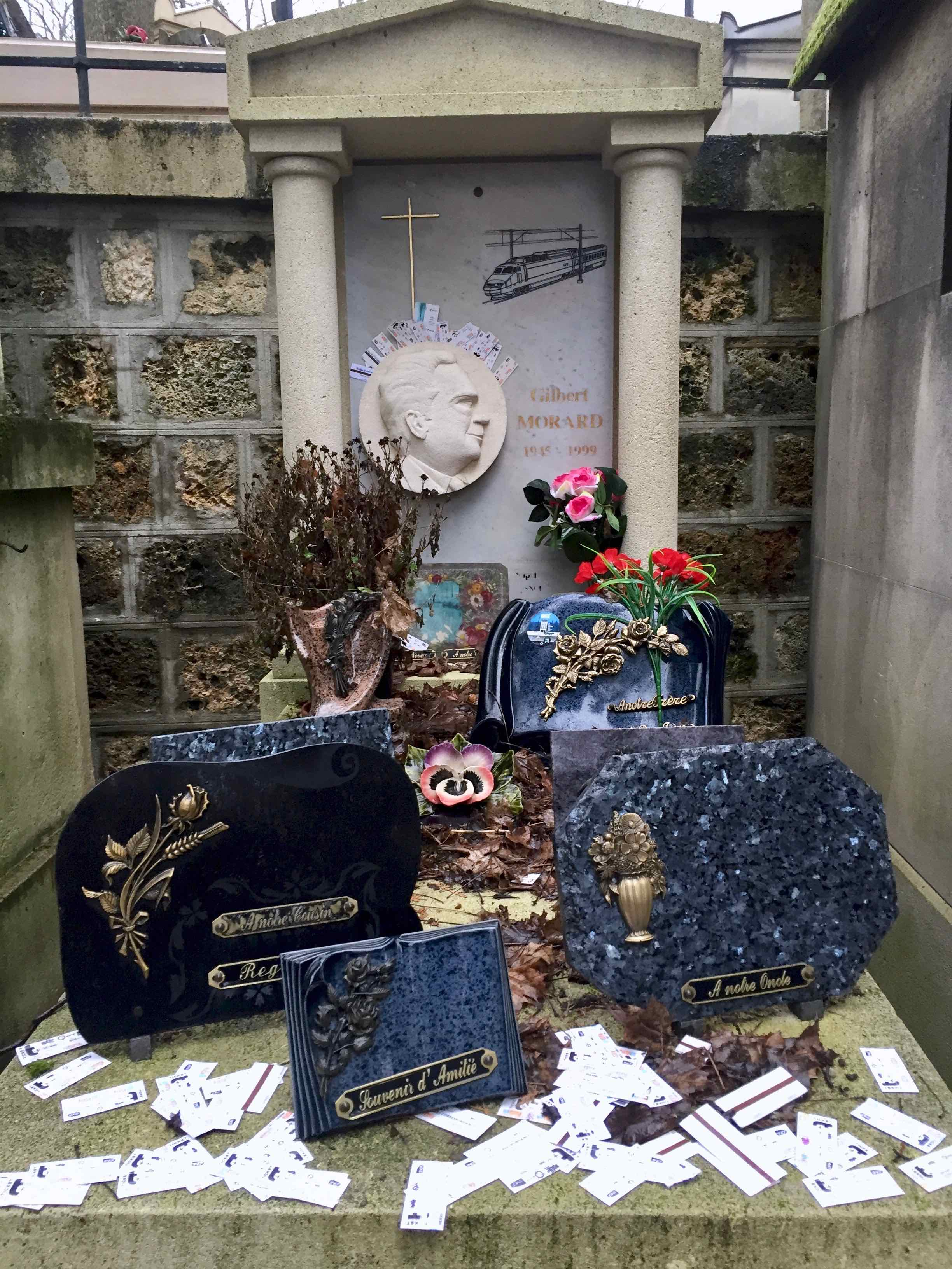 Tomb of Gilbert Morard with RATP tickets and TGV engraving Père Lachaise, Paris