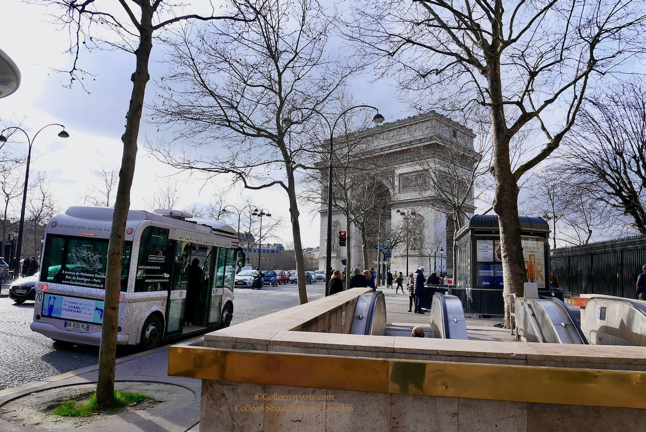 Fondation Louis Vuitton shuttle facing Arc de Triomphe next to metro