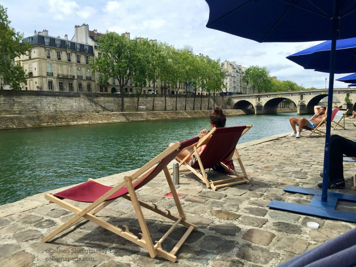 Sunbather looking into Seine Paris Plages 2020