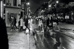 Parisians crossing the street at a crosswalk