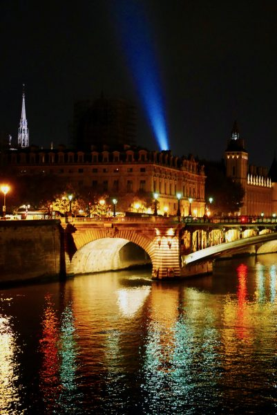 Image of Eiffel Tower beam, steeple of Sainte Chapelle, Hotel -Dieu, the Seine and Pont Notre-Dame